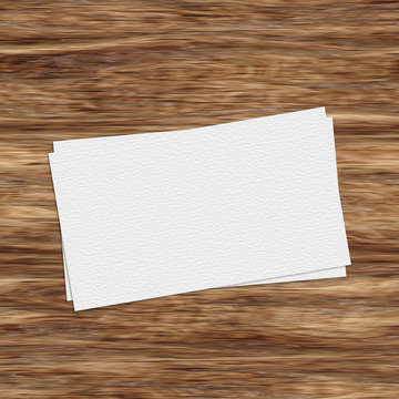 Business card template on wooden table