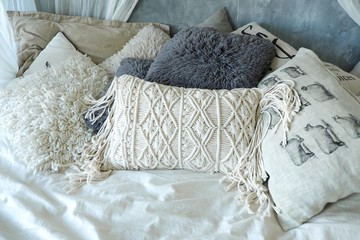 Lot of white and grey pillows for relaxing