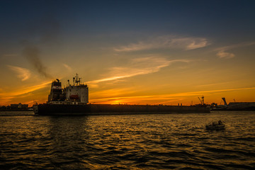 Large Cargo Ship On St Lawrence River At Sunset