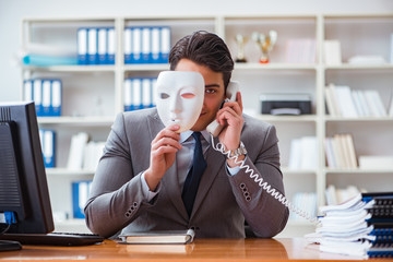 Businessman with mask in office hypocrisy concept - fototapety na wymiar