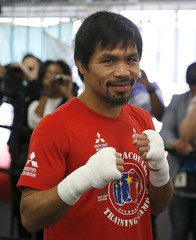 Boxer Manny Pacquiao poses for a photo before working out ahead of his bout with Tim Bradley