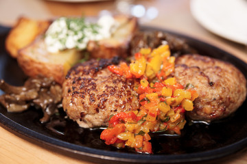 Meat dish - sсhnitzels, fried potato and garnish