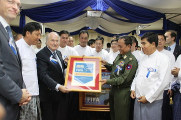 MANDALAY, March 15, 2011  International Federation of Association Football (FIFA) President Joseph S. Blatter presents souvenir to Chairman of Mandalay Region Peace and Development Council, Commander of Central Command, Brigadier General Ye Aung at the opening ceremony for the Youth Football Academy in Myanmar's second largest city, Mandalay on March 15, 2011. Mr. Blatter arrived here Tuesday afternoon on a two-day-visit in Myanmar to observe the facilities constructed under the arrangement of FIFA Goal Project.  (Xinhua/Lu Zihua) (Credit Image: © Lu Zihua/Xinhua/ZUMAPRESS.com)