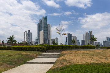 View of a park in the downtown of Panama City with modern buildings on the background, in Panama.