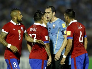 Uruguay's Godin and Chile's Medel argue next to Vidal and Isla during their 2018 World Cup qualifying soccer match in Montevideo