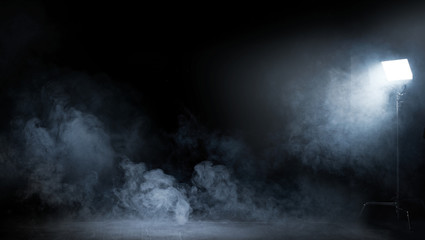 Conceptual image of a dark interior full of swirling smoke