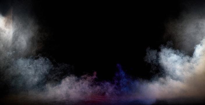 Dark interior full of dense, white fume