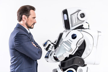 Determined male person looking at cyborg