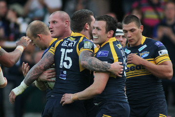 Leeds Rhinos' Shaun Lunt (C) celebrates after scoring a try