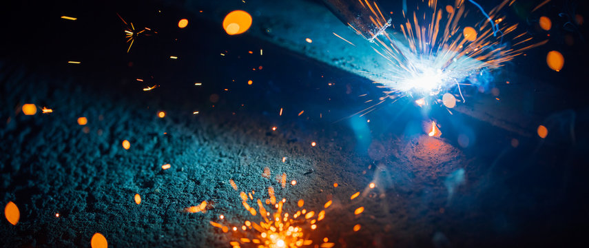 abstract welding sparks light, industrial background