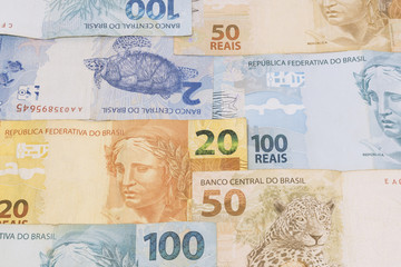 Brazilian money background. Bills called Real, different values. Economy of Brazil concept image.