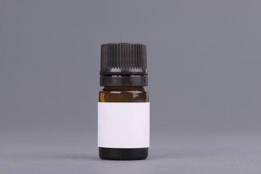 Dark medicine glass bottle jar, essential oil brown bottle. Mock up bottle with dropper. Container for perfume. Medical bank.