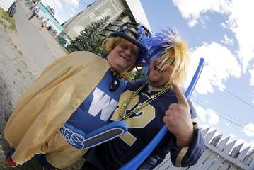 Winnipeg Blue Bomber fans before Riders vs Winnipeg Blue Bombers CFL football game in Regina