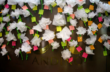 Little notes have been left for victims after an explosive device detonated in a restroom at the Andino shopping mall on Saturday, in Bogota