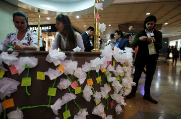 People leave notes for victims after an explosive device detonated in a restroom at the Andino shopping mall on Saturday, in Bogota