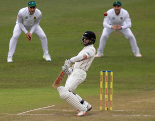 New Zealand's Kane Williamson ducks under a short ball during the second day of the first cricket test match against South Africa in Durban