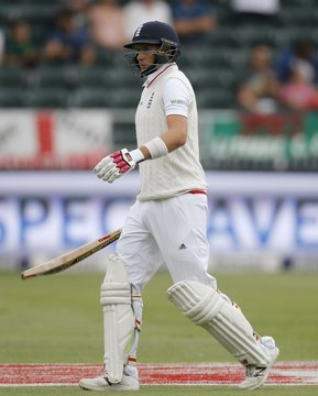 England's Joe Root leaves the crease after he was caught out by South Africa's Dane Vilas  during the third cricket test match in Johannesburg