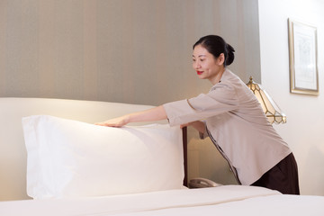 woman services in modern bedroom