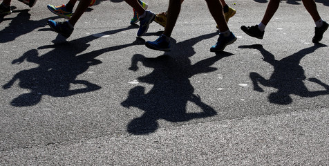 Athletes cast their shadows during the men's 20 kilometres race walk at the World Race Walking Team Championships in Rome