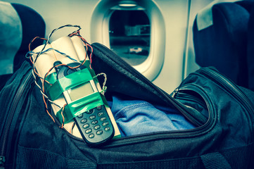 Dynamite bomb with phone in terrorist bag inside airplane