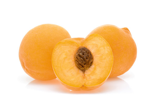 Yellow peach isolated on white background.