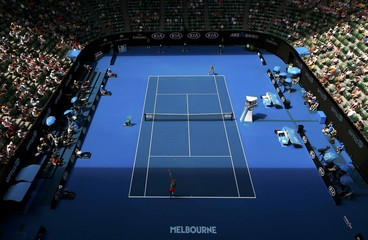 Germany's Kerber serves in the shadow of the roof during her quarter-final match against Belarus' Azarenka at the Australian Open tennis tournament at Melbourne Park