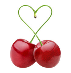 Isolated cherries. Heart shape from two cherries over white background
