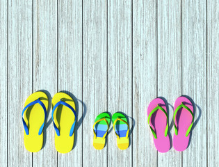 Flip-flops on wooden pier. Family vacation