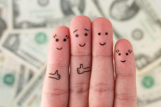 Fingers art of family on background of money.
