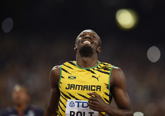 Bolt smiles after running the anchor leg to win the men's 4 x 100 metres relay final at the 15th IAAF Championships in Beijing