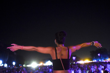 Rachel Littleton, 30, watches Muse as they perform during the Firefly Music Festival in Dover