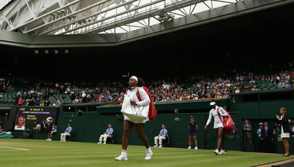 Women's Singles - USA's Serena Williams and USA's Venus Williams walk out on court for their fourth round match