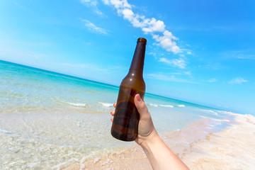 Beer bottle on a sandy beach