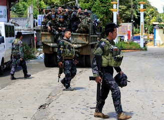 Government forces prepare to board as troops continue their assault against insurgents from the Maute group, in Marawi