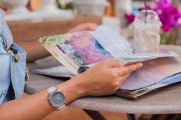 Woman reading a magazine.