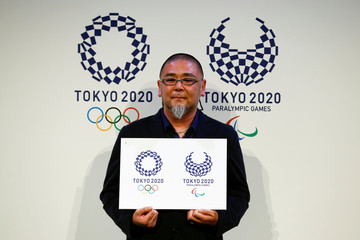 Artist Tokolo poses with his winning designs for the Tokyo 2020 Olympic Games and Paralympic Games after their unveiling in Tokyo