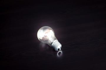 Light bulb on dark background.