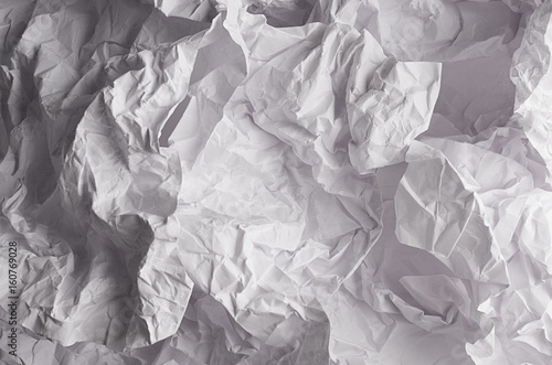Wall mural Crumpled wrinkled wavy grey paper texture, abstract polygon background.