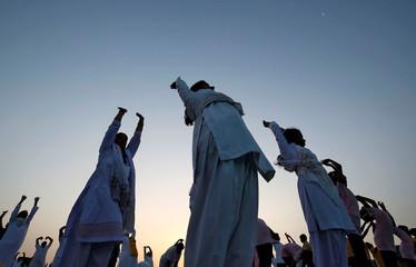 People perform yoga during a four-day long camp by yoga guru Baba Ramdev ahead of International Yoga day in Ahmedabad