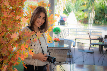 beautiful asia girl with camera in cafe with travel concept