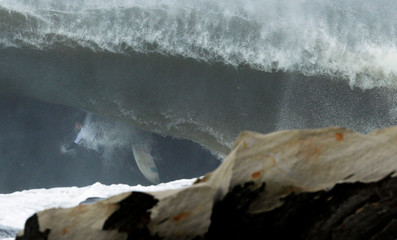 Vaculik wipes out on a large wave during the Cape Fear surfing tournament off Sydney's Cape Solander in Australia