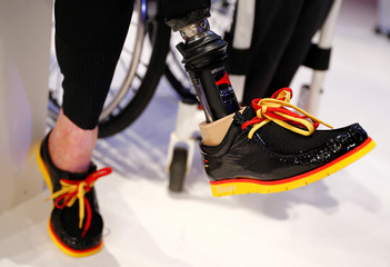 German paralympic cycling athlete Schindler wears a pair of the country's official Olympic shoes during the presentation of official uniforms for the 2016 Rio Olympics in Duesseldorf