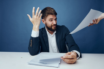 Businessman is not happy, businessman is working in the office, businessman is on a blue background