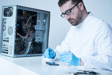 Lab engineer working on broken hard disk