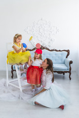 mother and daughters with candy