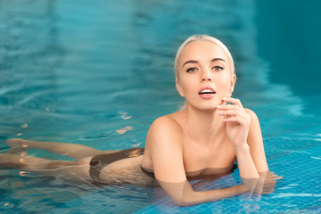 Beautiful girl in swimming pool