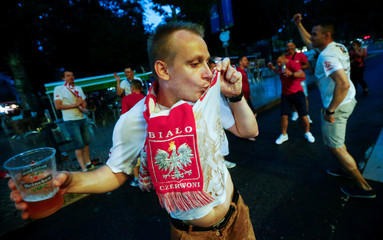 A Poland fan kisses his country's national jersey in St. Etienne  - EURO 2016