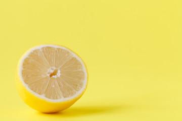 Freshly cut half and whole lemons