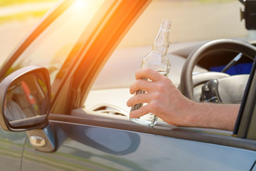 Man drinking alcohol in a car