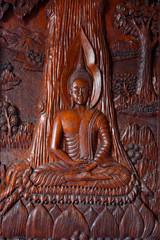 Buddha Image Wood Engraving on the door at Wat Asokara Temple in Thailand